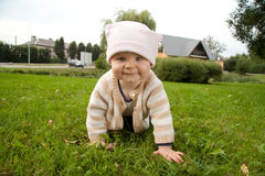 Baby girl in meadow royalty free stock photos