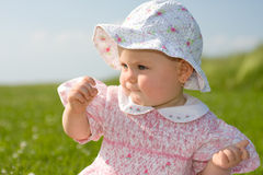 Baby girl in meadow Royalty Free Stock Image