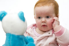 Baby girl meeting a teddy Royalty Free Stock Images