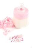 Baby girl milk bottle Stock Images