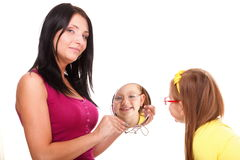 Baby girl and mirror mother Royalty Free Stock Image