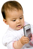 Baby girl with a mobile phone Royalty Free Stock Photography