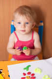 Baby girl molding from plasticine Royalty Free Stock Photography