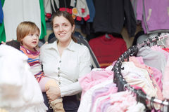 Baby girl with mother  at clothes store Stock Photography