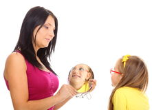 Baby girl and mother looking in mirror isolated Royalty Free Stock Images