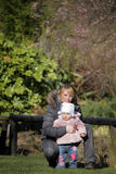 Baby girl with mother in the park Stock Image