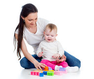 Baby girl and mother play together Stock Image