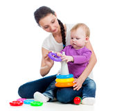 Baby girl and mother play together with toy Stock Photography