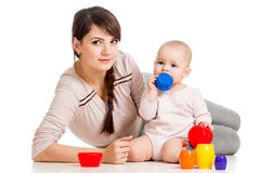 Baby girl and mother play together with toys. Kid girl and mother playing together with cup toys Stock Image