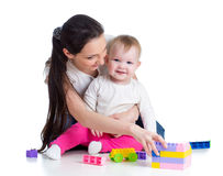 Baby girl and mother playing together Stock Photos