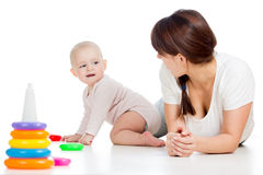 Baby girl and mother playing together Stock Images