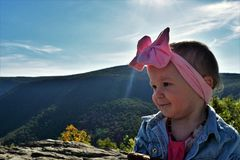 Baby girl on mountain top Royalty Free Stock Images