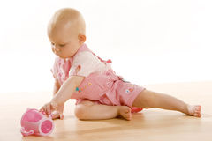Baby girl with a mug Royalty Free Stock Images
