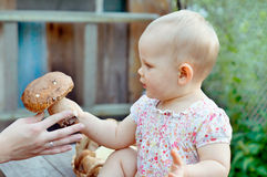 Baby girl with mushroom Royalty Free Stock Images