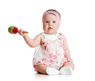 Baby  girl with musical toys Stock Photos