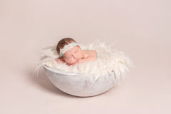 Baby girl napping on huge pillow Royalty Free Stock Photos
