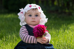 Baby girl on nature in the park outdoor Stock Photos