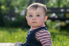 Baby girl on nature in the park outdoor Royalty Free Stock Photos