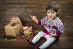 Baby girl near to the Christmas gifts Royalty Free Stock Photos