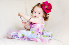Baby-girl-necklaces Stock Image