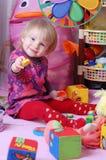 Baby girl in nursery stock photo