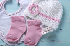 Baby girl nursery dummy pacifier, socks, bib and bonnet Royalty Free Stock Photo