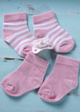 Baby girl nursery pink and white stripe socks Royalty Free Stock Images