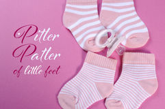 Baby girl nursery pink and white stripe sockswith sample text Stock Photo