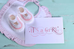 Baby girl nursery pink and white stripe wool booties and card stock images