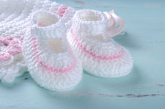 Baby girl nursery pink and white stripe wool booties close up Royalty Free Stock Photography