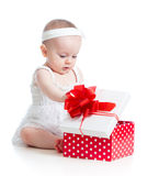 Baby girl opening gift box Royalty Free Stock Images