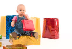 Baby girl opening gifts Stock Photo
