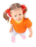 Baby girl in orange t-shirt.White background. Royalty Free Stock Images