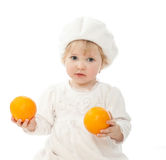 The baby girl with oranges Royalty Free Stock Images
