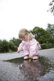 Baby Girl outdoor. Baby Girl in a pool of water Stock Photography