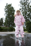 Baby Girl outdoor. Baby Girl in a pool of water Royalty Free Stock Photography