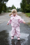 Baby Girl outdoor. Baby Girl in a pool of water Royalty Free Stock Photos