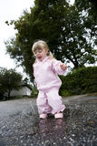 Baby Girl outdoor. Baby Girl in a pool of water Stock Photos