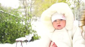 Baby girl outdoor winter with snow stock footage