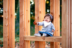 Baby girl outdoor with wood bench Stock Photography