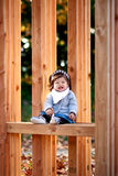 Baby girl outdoor with wood bench Royalty Free Stock Photo