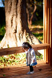 Baby girl outdoor with wood bench Stock Images