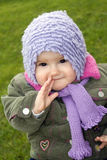 Baby girl outdoors. Sitting on the grass stock images