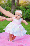 Baby girl outdoors in a dress Royalty Free Stock Photography