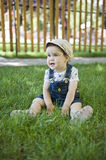 Baby girl outdoors in the grass Royalty Free Stock Images
