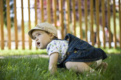 Baby girl outdoors in the grass Royalty Free Stock Photos