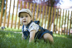 Baby girl outdoors in the grass Royalty Free Stock Photography