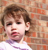 Baby Girl Outside. Beautiful baby girl outside against a red brick house. Shot with Canon 20D Stock Images