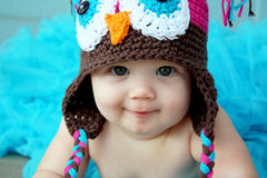 Baby girl in own hat Stock Images
