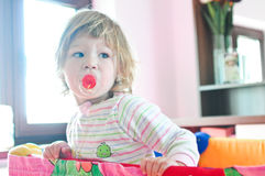 Baby girl with pacifier Royalty Free Stock Images